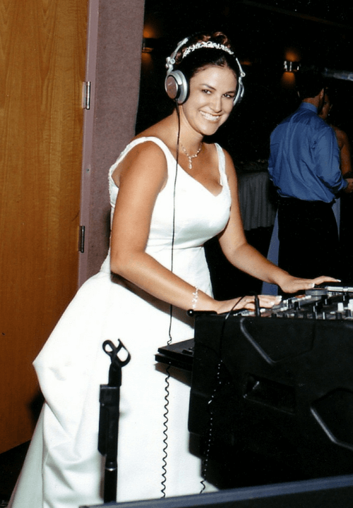 bride wearing DJ's headphones