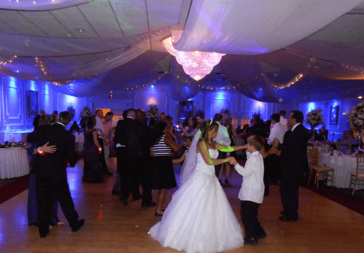 bride dancing with boy on dance floor