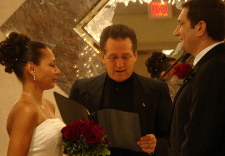 Jonathan performing wedding ceremony with bride and groom